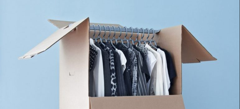 a carboard box with clothes