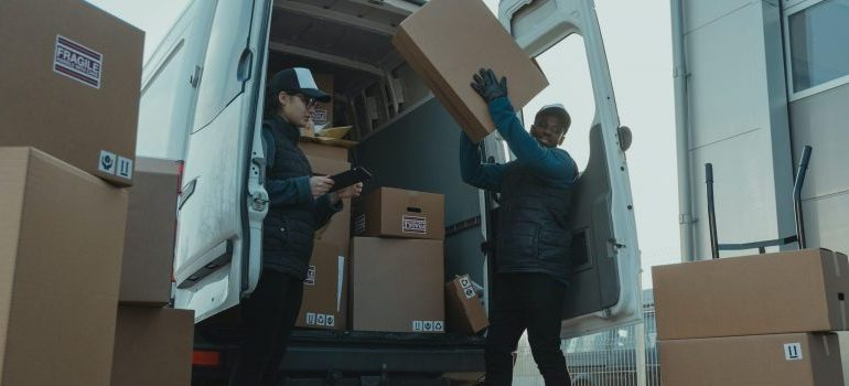 moving crew unloading a moving van