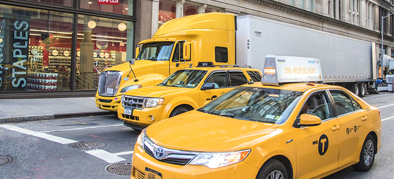 Manhattan residential movers parked a truck on a street
